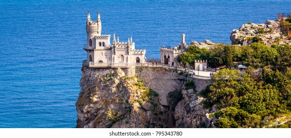 Panoramic view of the castle Swallow's Nest on the rock over Black Sea in Crimea, Russia. Swallow's Nest is landmark and symbol of Crimea. Beautiful panorama of Crimea coast on sunny summer day.
