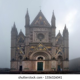 Panoramic view of Cathedral of Orvieto  morning in the fog (Duomo di Orvieto) Umbria Italy