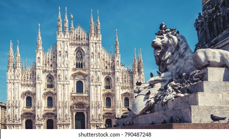 Panoramic view of Cathedral Square with sculpture of lion in summer, Milan, Italy. Famous Milan Cathedral (Duomo di Milano) in background. Gothic Milan church is main tourist attraction of Milan city.