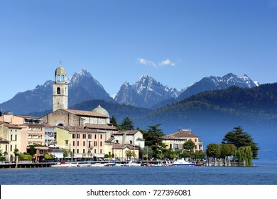 panoramic view to the center of Salo at the lake Garda in Italy, Lombardia with alpes and blue sky