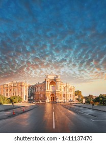 Panoramic view of the central part of the city of Odessa with a beautiful building of the Opera and Ballet Theater and the adjacent park on the background of the stunning sunset sky with feather
