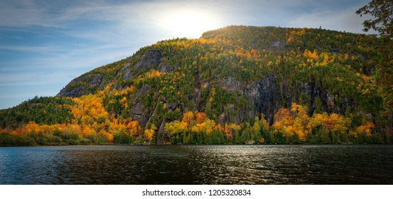 Panoramic view of Chapel Pond reflecting autumn colors in Keene Valley, the Adirondacks, New York
