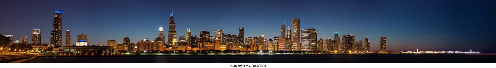 Panoramic view of the Chicago Skyline at Night including the Pier