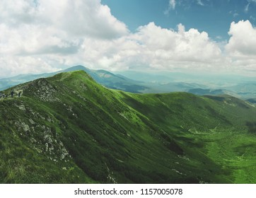 panoramic view of Chornohora mountain ridge and beautiful cluody sky from slopes of Hoverla mountain. mountain slope in low lying cloud with the evergreen conifers shrouded in mist in a scenic