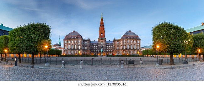 Panoramic view of Christiansborg, palace and government building, the seat of parliament, during morning blue hour, Copenhagen, capital of Denmark