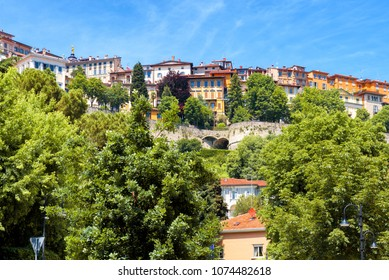 Panoramic view of Citta Alta in Bergamo, Italy. Beautiful scenic panorama of Old town or Upper City of Bergamo on a sunny day. Ancient buildings of Bergamo on the hill in summer.