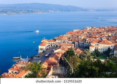 panoramic view of the city of Arona and Lake  Maggiore with in the background the Lombardy region