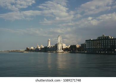 Panoramic view of the city of Bari, in the south of Italy, from the sea to historic buildings and the Ferris wheel.