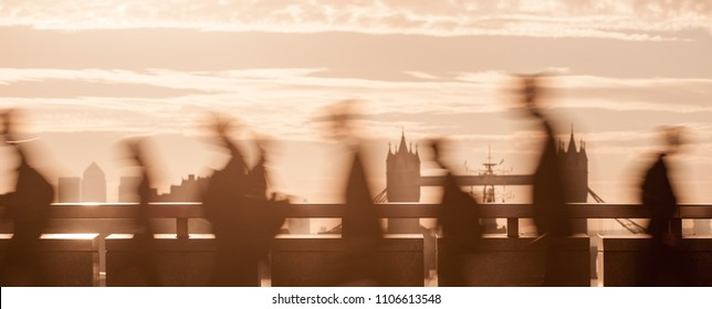 Panoramic view of city commuters. Intentionally blurred image of workers on London Bridge. Unrecognizable faces. London, UK. Concept for Londoners, modern life, management, corporate, business, future