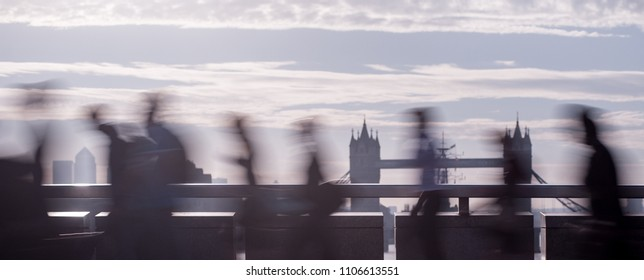 Panoramic view of city commuters. Intentionally blurred image of workers on London Bridge. Unrecognizable faces. London. Concept for Londoners, modern life, management, corporate, finance, business