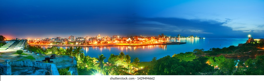 panoramic view of the city of habana and its bay seen from the castle of morro at nightfall
