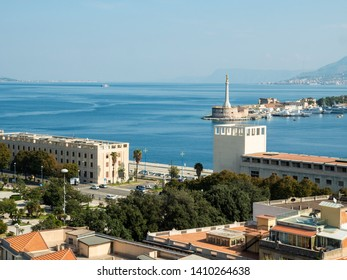 Panoramic view of the city of Messina from the bell tower of the Cathedral of Messina. The Strait of Messina and the Madonna of the Letter during a beautiful day, Sicily, Italy.