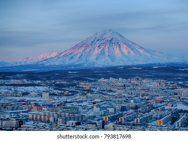 Panoramic view of the city Petropavlovsk-Kamchatsky and volcanoes: Koryaksky Volcano, Avacha Volcano, Kozelsky Volcano. Russian Far East, Kamchatka Peninsula.