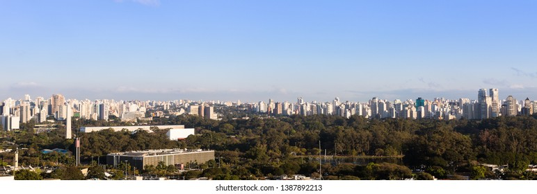 Panoramic view of the city of Sao Paulo with the Ibirapuera park and the Legislative Assembly of Sao Paulo in the foreground.