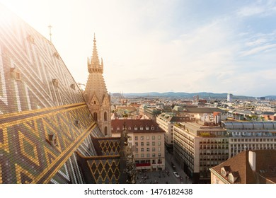 Panoramic view of the city at sunset from the viewing platform of the North Tower of St. Stephen's Cathedral in Vienna, Austria