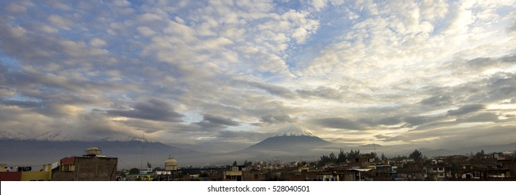 Panoramic view of a Cloudy Sunrise in Arequipa - Peru with the Misti Volcano full of snow