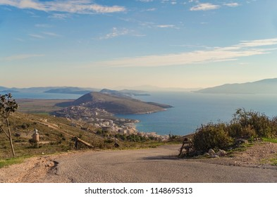 Panoramic view of coast of the Ionian Sea in beams of the evening sun. Nature and travel. Albania, Vlora County, near Saranda