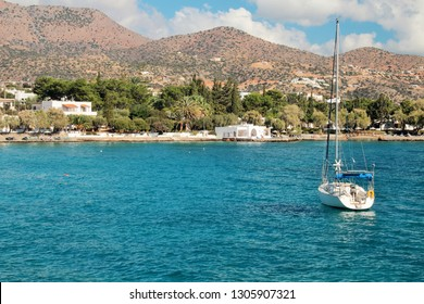 Panoramic view of the coast of the island, white yacht on the water near the shore, clear sea, clear sky, a great place to relax on vacation