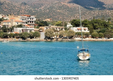 Panoramic view of the coast of the island, white yacht on the water near the shore, clear sea, a great place to relax on vacation