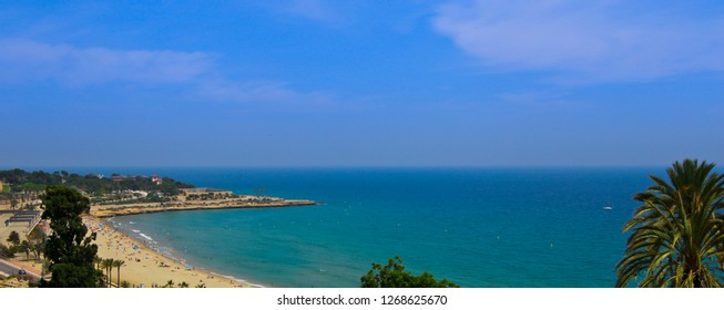 Panoramic view of coast of Tarragona, beach in La Pineda in sunny day. Tarragona, Catalunya, Spain