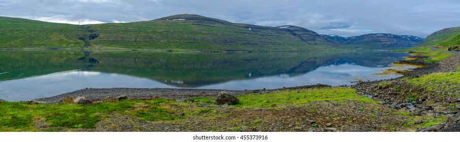 Panoramic view of coastline and landscape along the Isafjordur fjord, in the west fjords region, Iceland