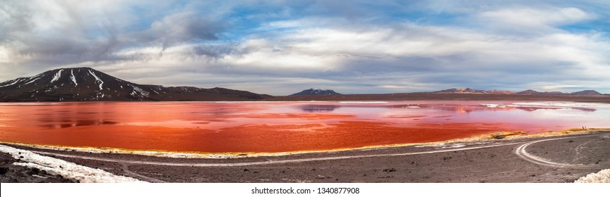 Panoramic view of the Colored Lagoon (Laguna Colorada), Potosí, Bolivia. The red color of its waters is caused by red sediments and pigmentation of algae.