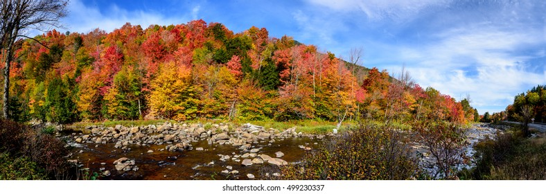 Panoramic view of colorful autumn foliage along the Ausable River in the Adirondacks, Wilmington, New York
