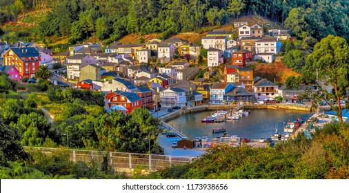 Panoramic view of the colorful fishing village of O Barqueiro on the Cantabric sea in Galicia, Spain.