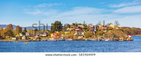 Panoramic view of colorful houses and cabins in Oslo islands. Typical small houses in nordic countries on the seafront. Travel and architecture concepts