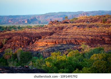 Panoramic view of colorful rock formation at beautiful sunset light in Australian Kakadu park.