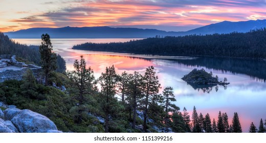 Panoramic view of a colorful sunrise over Emerald Bay and Eagle Point off Lake Tahoe in California.