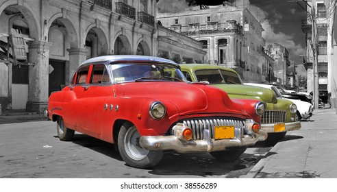 Panoramic view of colorful vintage classic cars parked in street of old Havana, cuba