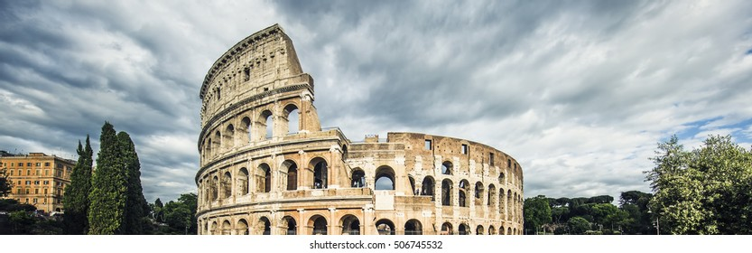Panoramic view of Colosseum with clouds, Rome, Italy.