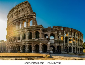 Panoramic view of Colosseum or Coliseum in Rome at sunrise and morning sun, Italy, Europe
