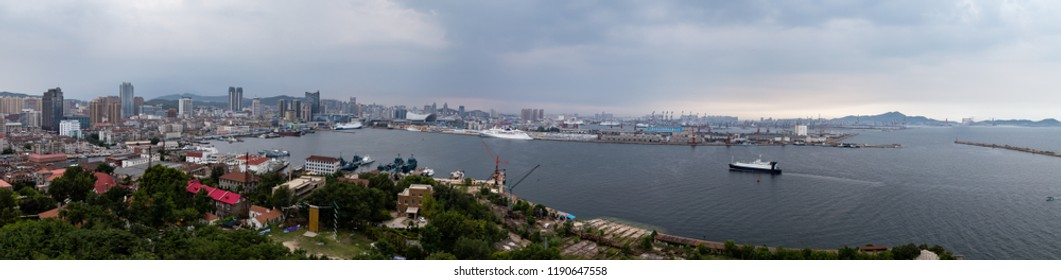 Panoramic view of the commercial port of Yantai, China, from Yantai Shan, a hill in the old town with a lighthouse, a temple and the smoke signal terrace that gives the name to the city