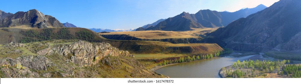 Panoramic view of the confluence of the Siberian rivers Chuya and Katun in spring in the Altai Mountains of Russia