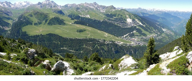 panoramic view of courchevel winter resort station during summer taken from a neighbour mountain