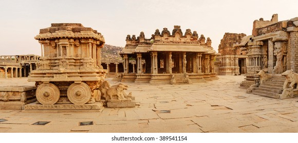 Panoramic view in courtyard of Vittala Temple at sunset in Hampi, Karnataka, India