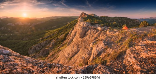 Panoramic view of Crimea mountain valley in a sunset light. View from mt. Sedam-Kaya to the west. Summer travel time.