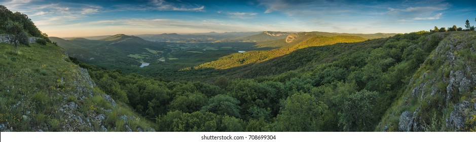 Panoramic view of Crimea mountain valley at sunset light.