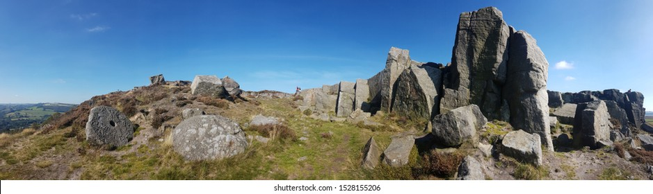 A panoramic view of Curbar, a millstone grit outcrop near the village of Curbar in the Derbyshire Dales, England.