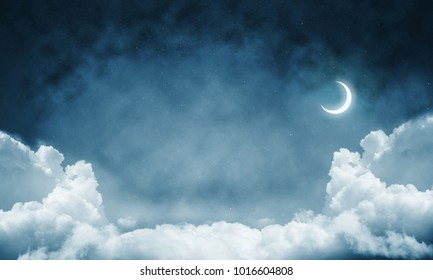 Panoramic view of dark cloudy skyscape at night with new month. Wallpaper or backdrop with copyspace.