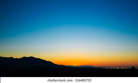 Panoramic view of dark Silhouette of Mountains on colorful sunrise sky background