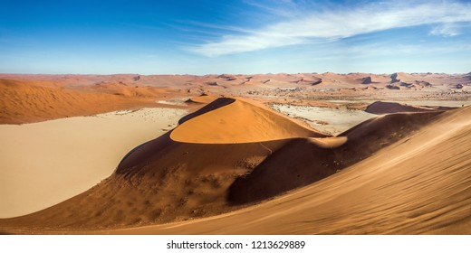 Panoramic view of Deadvlei and Sossusvlei dunes under blue sky from Big Daddy dune. Namib Naukluft national park, Namibia.