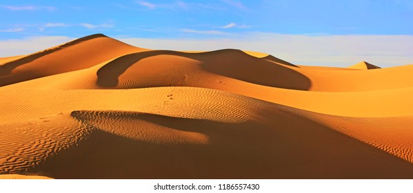 Panoramic view of the desert with beautiful sand dunes and blue sky, Morocco