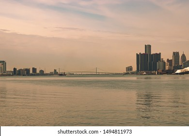 Panoramic view of the Detroit Windsor skyline with the Ambassador Bridge connecting the United States with Canada.