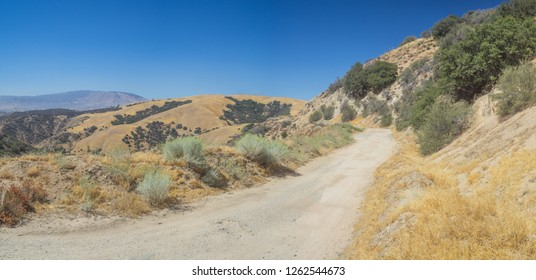 Panoramic view of dirt road in California mountains in Angeles National Forest.