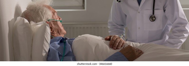 Panoramic view of doctor with elderly hospice patient
