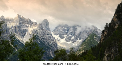 Panoramic view of the Dolomitic Group of Cristallo with dramatic cloudy sky as seen from valle di Landro, near Cortina D'Ampezzo. Sexten Dolomites, Italy.