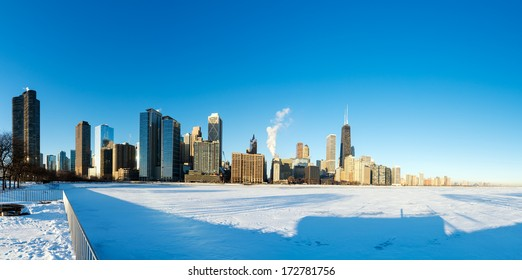 Panoramic view of downtown Chicago with frozen Lake Michigan in the foreground